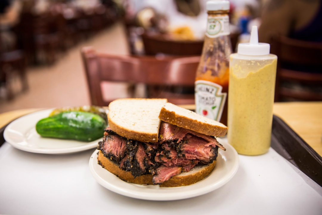 NEW YORK, NY - AUGUST 29:  In this photo illustration, a pastrami on rye sandwich is displayed in Katz's Deli on August 29, 2014 in New York City. The iconic New York deli recently sold the air rights to above their building, potentially allowing developers to build on top of it.  (Photo by Andrew Burton/Getty Images)
