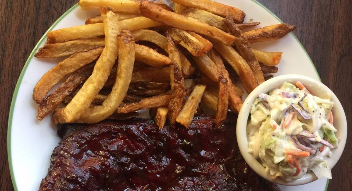 french fries, bbq meat, and coleslaw on a plate