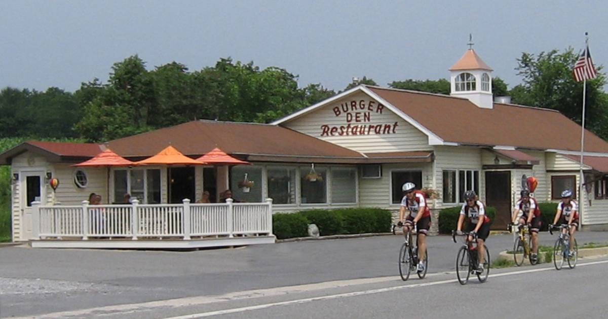 people riding bikes by a restaurant