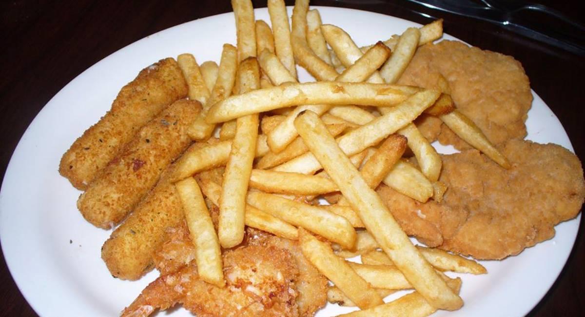 plate of fries, mozz sticks, and fried shrimp