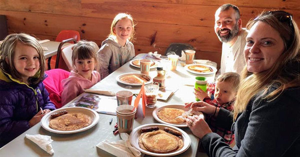 a family pancake breakfast in a restaurant