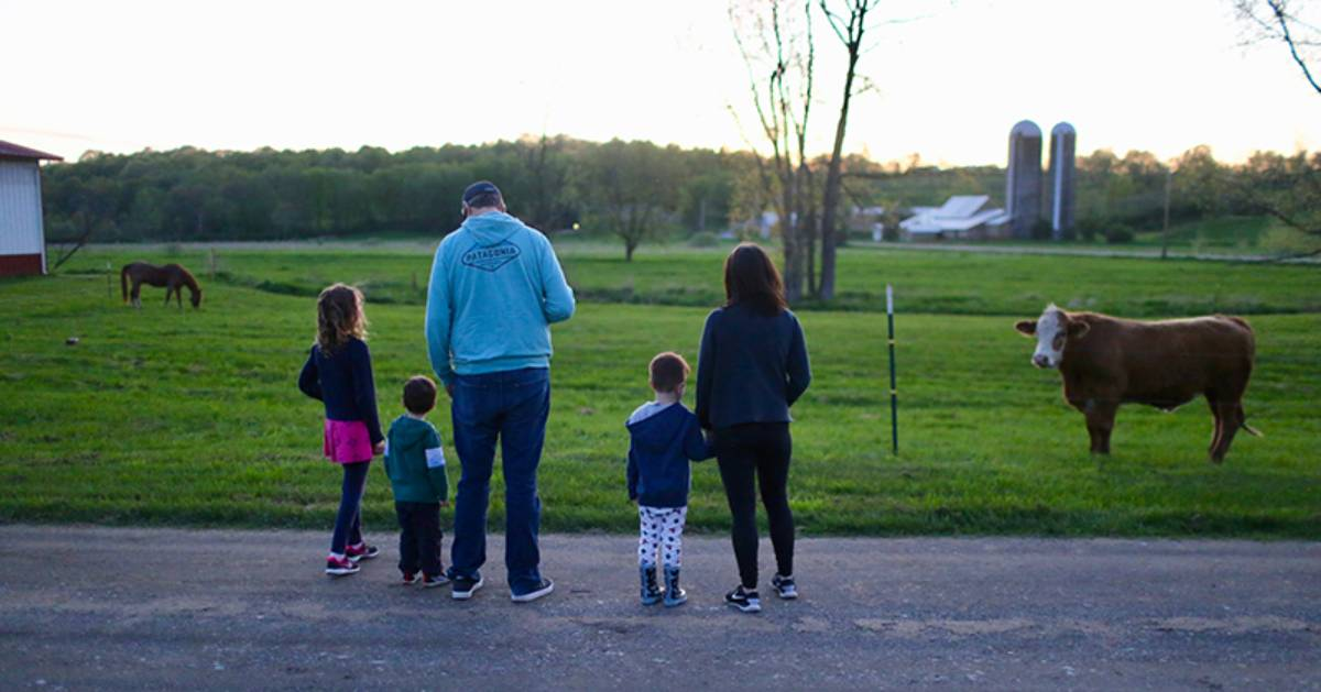 family looking at a farm
