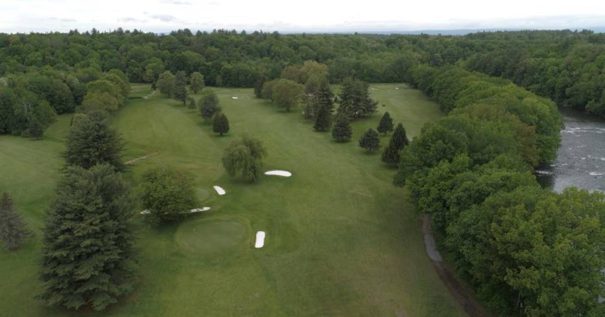 overhead view of a golf course and trees