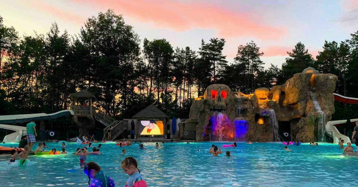 The pool at Moose Hill Lock which has a mountain shaped like a skull with water coming out of its mouth. There is also a large screen showing some cartoons.
