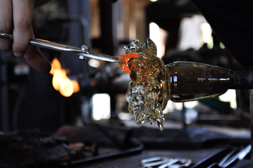 A glassblower creates a piece of Upstate New York Art
