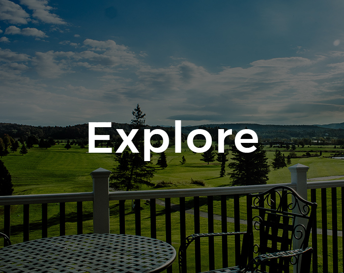 A view of a table with a beautiful view of a field with the word Explore overlaid on it